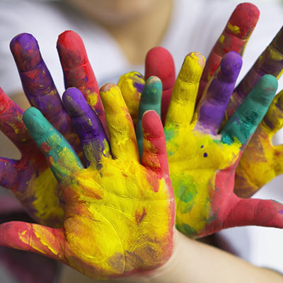bunch of children's fingerpaint stained hands
